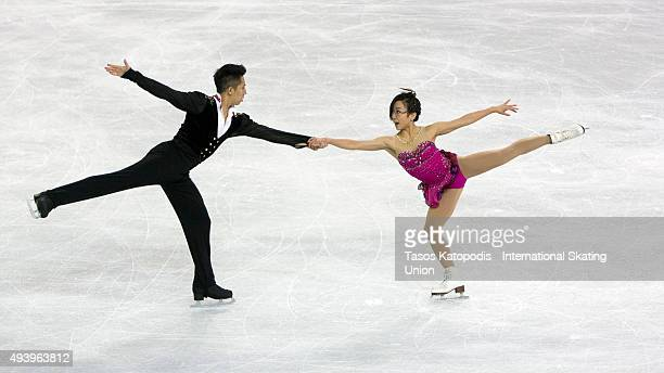 Cong Han and Wenjing Sui of China skate during the pairs short program on October 23 2015 in Milwaukee Wisconsin