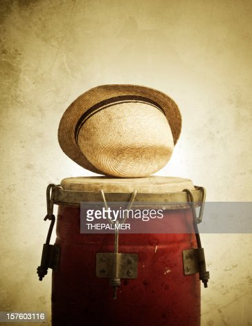 congas and straw hat on grunge background
