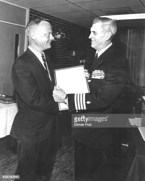 Conger John J Dr left Capt Thomas J Canty USN Credit Denver Post