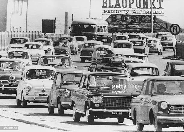 Congested traffic outside Milan as citydwellers leave for the coast and the mountains to escape the summer heat 6th August 1963