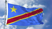 Congo Democratic Republic of the Flag in a Blue Sky. Use this clip loud and proud to express loyalty and love to our country. It is a seamless loop with luma channel.