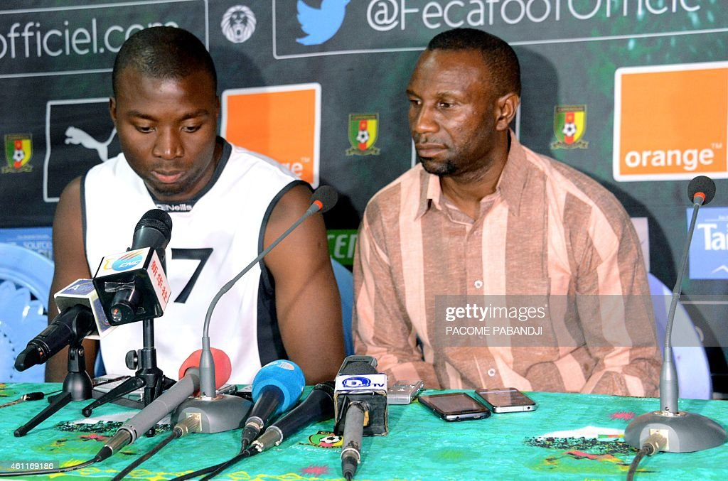 DR Congo national team coach Florent Ibengue (R) and team captain <a gi-track='captionPersonalityLinkClicked' href=/galleries/search?phrase=Cedric+Mongongu&family=editorial&specificpeople=4305033 ng-click='$event.stopPropagation()'>Cedric Mongongu</a> speak to the press during a training session by the DR Congo national football team in Yaounde on January 8, 2015. RD Congo, which is placed in Group B in the 2015 Africa Cup of Nations in Equatorial Guinea, is training in preparation for the Africa Cup of Nations 2015 which begins on January 17 until February 8.