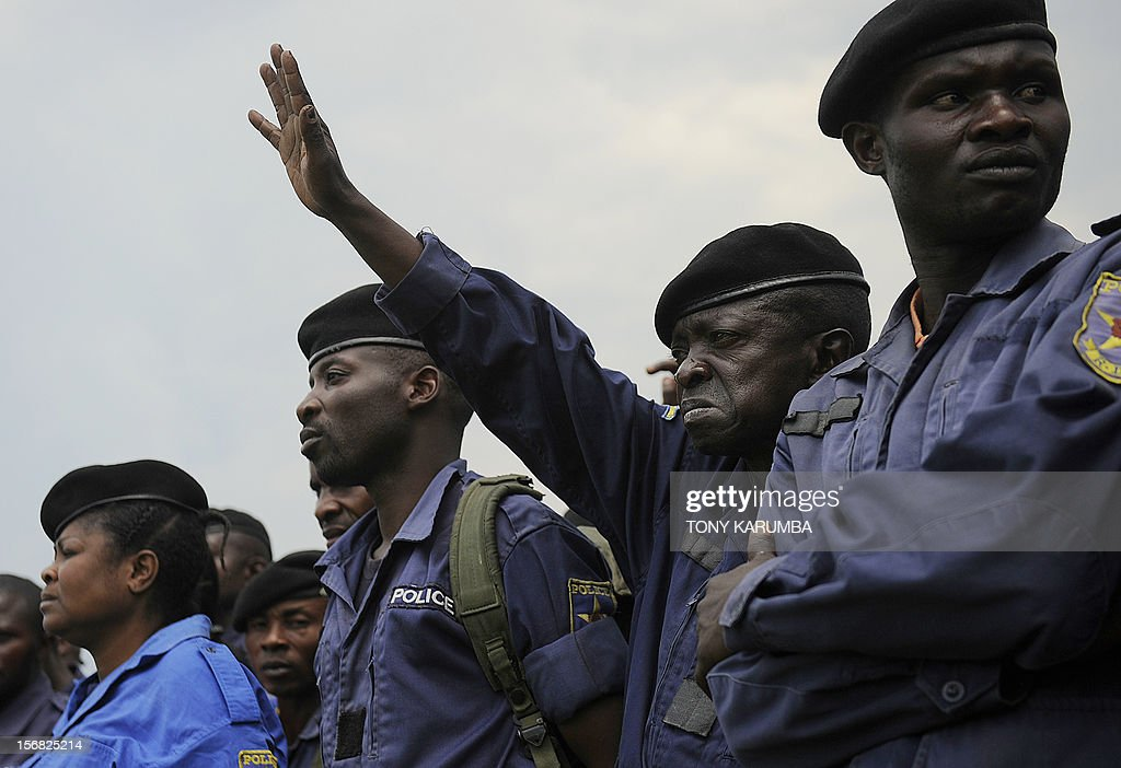 DR Congo police officers participate in a registration excercise on November 22, 2012 carried out by rebel group M23 at the Goma stadium. The M23 called on members of the Congo police and military to register for re-training by its troops which is meant to integrate them into the rebel movement's new style of leadership even as the rebels, rejected international calls to pull out of the strategic eastern city of Goma, demanding peace talks with President Joseph Kabila before ending an offensive that has stoked fears of a wider conflict and humanitarian catastrophe. The political leader of the M23 rebel group in the Democratic Republic of Congo, Jean-Marie Runiga Lugerero headed to Uganda on Thursday for talks with President Yoweri Museveni, currently the Chief of the International Conference on the Great Lakes Region. AFP PHOTO/Tony KARUMBA