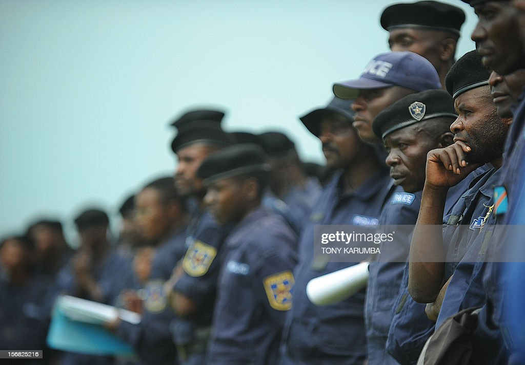 DR Congo police officers participate in a registration excercise on November 22, 2012 carried out by rebel group M23 at the Goma stadium. The M23 called on members of the Congo police and military to register for re-training by its troops which is meant to integrate them into the rebel movement's new style of leadership even as the rebels, Thursday, rejected international calls to pull out of the strategic eastern city of Goma, demanding peace talks with President Joseph Kabila before ending an offensive that has stoked fears of a wider conflict and humanitarian catastrophe. The political leader of the M23 rebel group in the Democratic Republic of Congo, Jean-Marie Runiga Lugerero headed to Uganda on Thursday for talks with President Yoweri Museveni, currently the Chief of the International Conference on the Great Lakes Region. AFP PHOTO/Tony KARUMBA