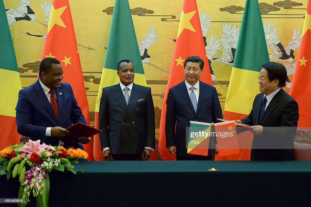 Congo President Denis Sassou N'guesso (Center L) and Chinese President Xi Jinping (Center R) attend a signing ceremony at the Great Hall of the People on June 12, 2014 in Beijing, China. The Congo President is on a visit to China from June 11 to 19.