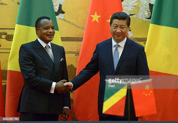 Congo President Denis Sassou N'guesso shakes hands with Chinese President Xi Jinping during a signing ceremony at the Great Hall of the People on...