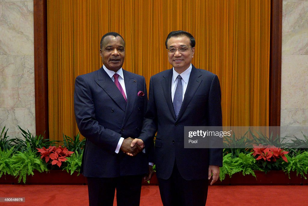 Congo President Denis Sassou N'guesso (L) shakes with Chinese Premier <a gi-track='captionPersonalityLinkClicked' href=/galleries/search?phrase=Li+Keqiang&family=editorial&specificpeople=2481781 ng-click='$event.stopPropagation()'>Li Keqiang</a> (R) at the Great Hall of the People in Beijing on June 13, 2014. Denis Sassou N'guesso is on a visit to China from June 11 to 19.