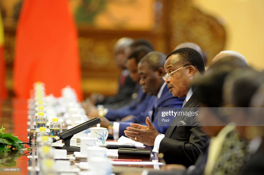 Congo President Denis Sassou N'guesso (C) talks with Chinese President Xi Jinping (not in picture) at the Great Hall of the People on June 12, 2014 in Beijing, China. The Congo President is on a visit to China from June 11 to 19.