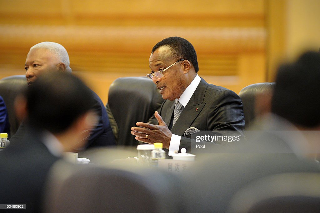 Congo President Denis Sassou N'guesso (C) talks with Chinese President <a gi-track='captionPersonalityLinkClicked' href=/galleries/search?phrase=Xi+Jinping&family=editorial&specificpeople=2598986 ng-click='$event.stopPropagation()'>Xi Jinping</a> (not in picture) at the Great Hall of the People on June 12, 2014 in Beijing, China. The Congo President is on a visit to China from June 11 to 19.