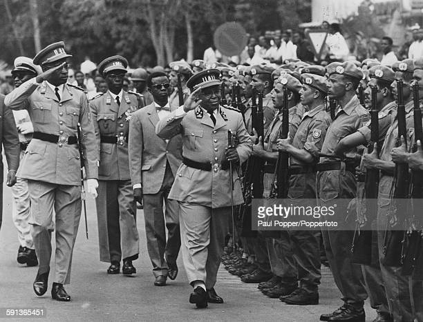 CongoLeopoldville President Joseph KasaVubu salutes as he inspects Guard of Honour of Tunisian UN Troops with 'strongman' General Mobutu Sese Seko in...