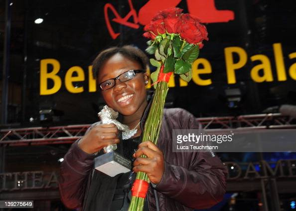 Congolese actress Rachel Mwanza celebrates winning the Silver Bear for Best Actress in the film 'Rebelle' after the Closing Ceremony during day ten...
