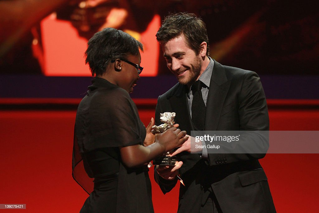 Congolese actress Rachel Mwanza receives the Silver Bear for Best Actress in the film Rebelle by jury member Jake Gyllenhaal at the Closing Ceremony...