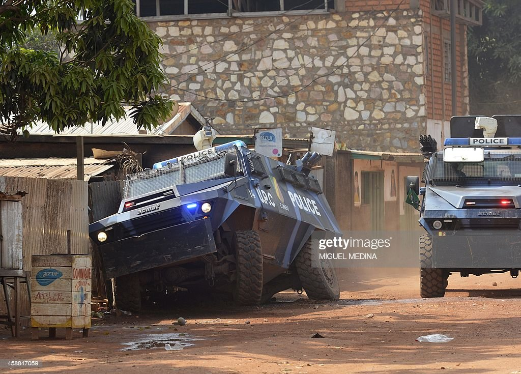 Congolese armored vehicle of the UPC Congo (Unite de Police Constituee in French, coming from Congo Brazzaville) scatter a protest against the French 'Sangaris' intervention in the Galabadia neighbourhood close to the Centrafrican President's private house in the eigth district of Bangui on December 22, 2013. According to Muslim residents, clashes broke out early on December 22 between the French soldiers and the ex-Seleka fighters, who mounted a successful coup in March but have since refused to lay down their arms. They said three fighters were killed and several others were wounded, but their claims have not been confirmed by the French military.