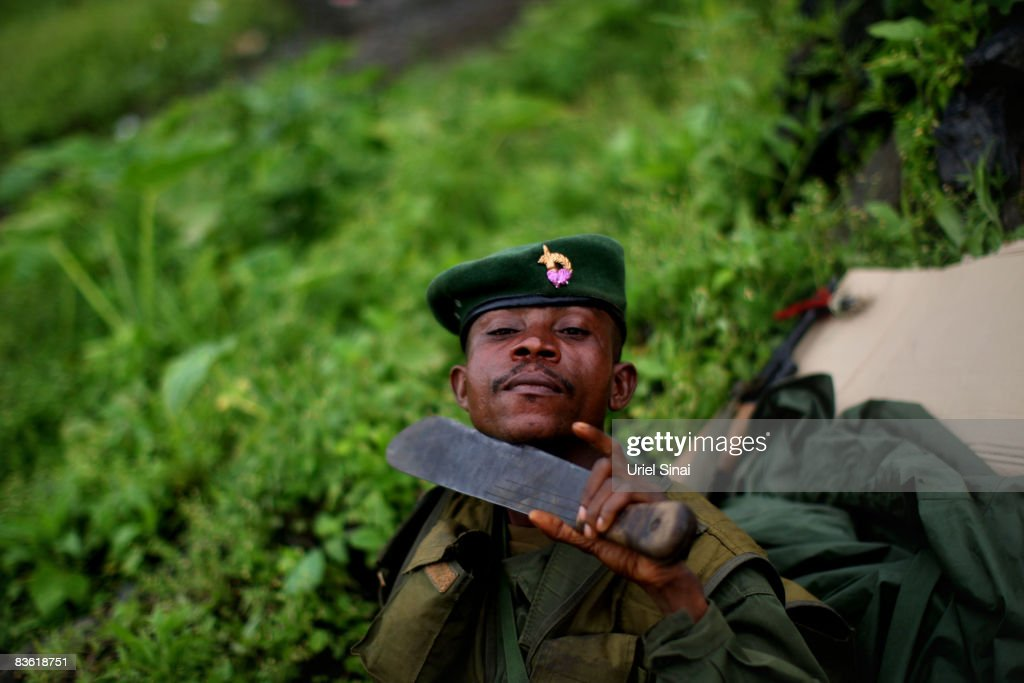 A Congolese army soldier poses with a machete knife on the frontline on November 09 2008 just outside the town of Goma the Democratic Republic of...