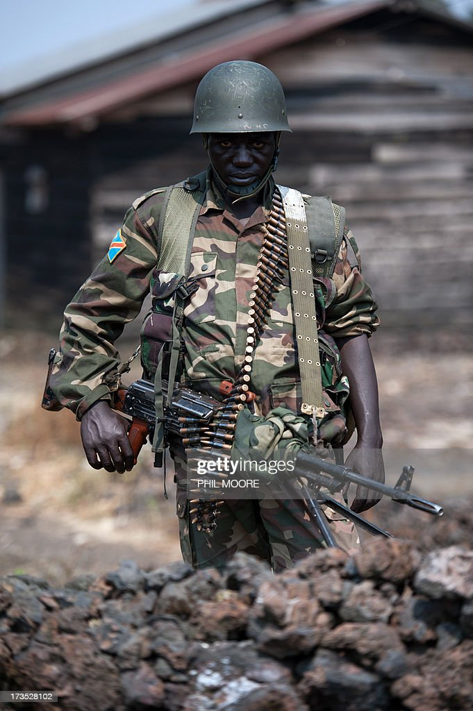 A Congolese army soldier stands for a photograph at a foward position in Kanyarucinya, around 12 kms from Goma in the east of the Democratic Republic of the Congo, on July 16, 2013. The army in the Democratic Republic of Congo on July 16 pursued an offensive against rebels of the M23 movement to protect the North Kivu provincial capital of Goma. M23, a movement launched by Tutsi defectors from the army who accuse the Kinshasa government of reneging on a 2009 peace deal, last year occupied Goma for 10 days before pulling out under international pressure.