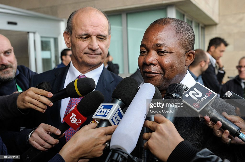 Congolese barman, Patrick Lumumba (R), and his lawyer Carlo Pacelli talk to the press outside the new Courthouse during a break from the appeal trial of Amanda Knox and Raffaele Sollecito on September 30, 2013 in Florence, Italy. Both Knox and Sollecito had the convictions overturned and were released in 2011 after four years in prison. Knox has no plans to return to Italy for the retrial and will be represented by her laywers in court.