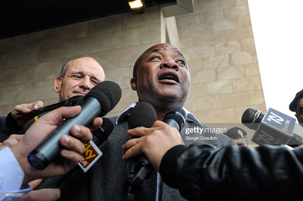 Congolese barman, Patrick Lumumba (C), and his lawyer Carlo Pacelli talk to the press outside the new Courthouse during a break from the appeal trial of Amanda Knox and Raffaele Sollecito on September 30, 2013 in Florence, Italy. Both Knox and Sollecito had the convictions overturned and were released in 2011 after four years in prison. Knox has no plans to return to Italy for the retrial and will be represented by her laywers in court.