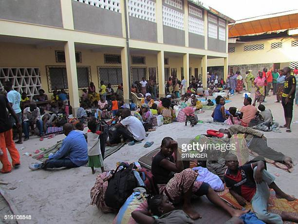 Congolese displaced residents from the southern districts of Brazzaville take shelter in a church after fleeing intense clashes between security...