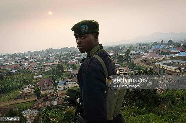 A Congolese fighter of the rebel M23 group looks on from a hill in Bunagana a town near the Ugandan border on July 8 2012 Colonel Sultani Makenga...