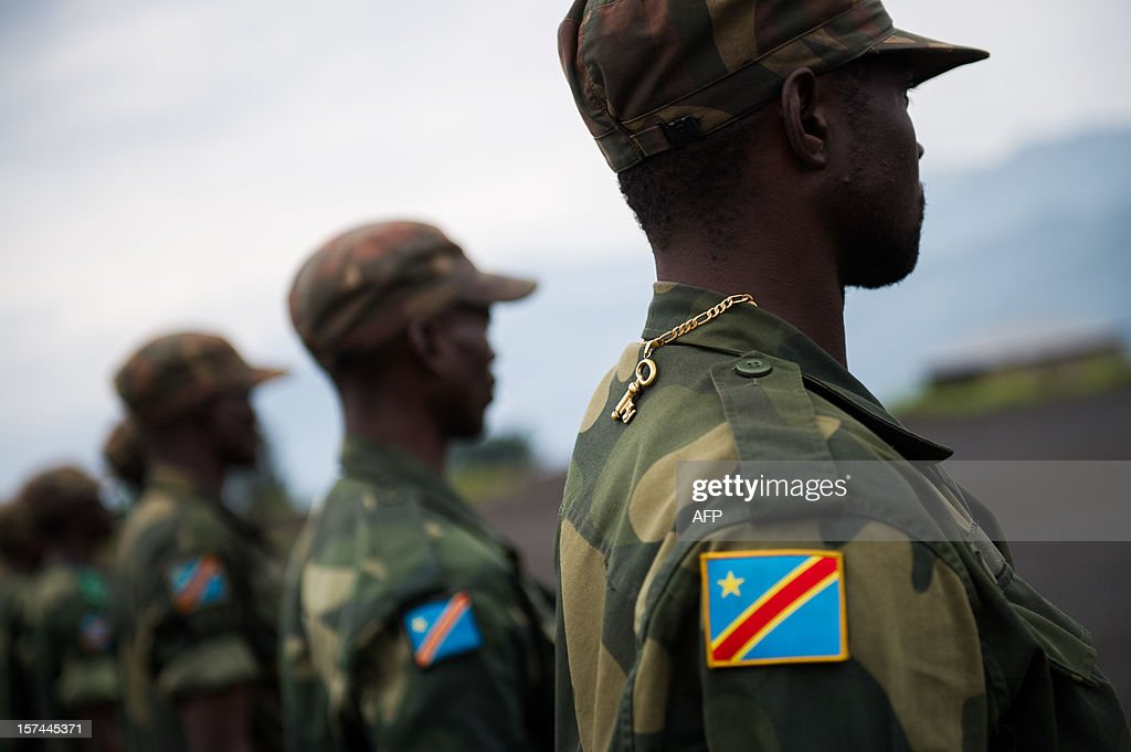 A Congolese government army (FARDC) soldier stands with a key around his neck during a military address at a military base in Sake, 26km from Goma in the east of the Democratic Republic of the Congo on December 3, 2012. FARDC Colonel Jean-Claude Yav from the Joint Verification Mechanism addressed Congolese troops this morning ahead of an expected move to Goma later today.
