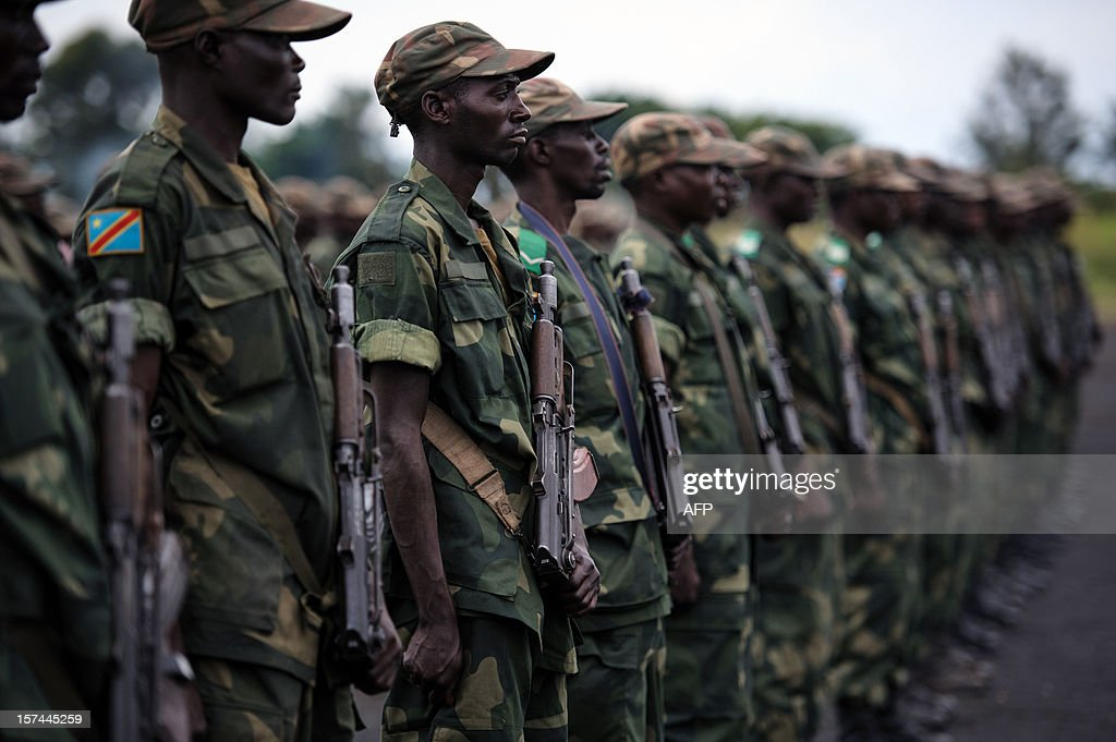 Congolese government army (FARDC) soldiers stand during a military address at a military base in Sake, 26km from Goma in the east of the Democratic Republic of the Congo on December 3, 2012. FARDC Colonel Jean-Claude Yav from the Joint Verification Mechanism addressed Congolese troops this morning ahead of an expected move to Goma later today.