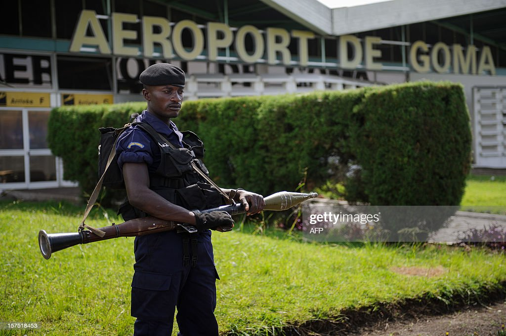A Congolese government policeman stands with a rocket-propelled grenade launcher outside the airport in Goma in the east of the Democratic Republic of the Congo on December 4, 2012, during a visit by Congo's interior minister. The airport was held by United Nations forces whilst M23 overran the city two weeks ago, before leaving on Saturday. Government troops returned to the city yesterday.