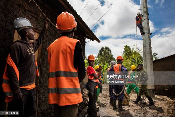 Congolese men and a Belgian engineer lay electricity pylons for the power that will be supplied by Matebi Hydroelectric station The powerstation is...
