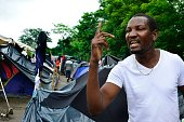 Congolese migrant Samuel Yeaye Omar speaks in an encampment of Africans in Penas Blancas Guanacaste Costa Rica in the border with Nicaragua on July...