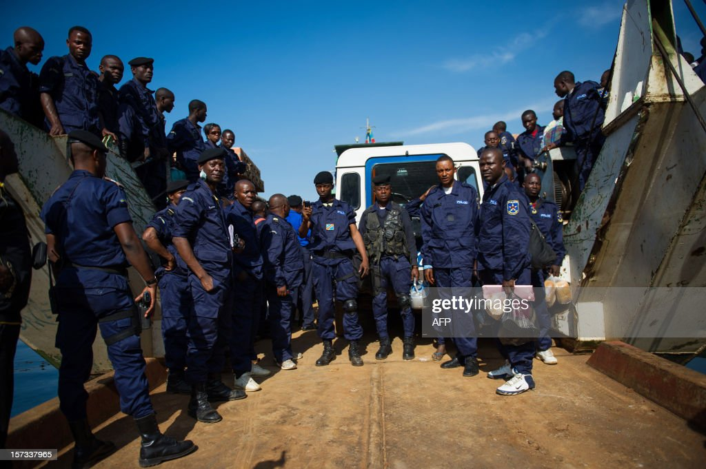 Congolese national police officers prepare to disembark from a boat at the port in the city of Goma, in the east of the Democratic Republic of Congo, on December 2, 2012. After M23 rebels pulled out of Goma yesterday, 166 government police officers arrived this morning from Bukavu. AFP PHOTO / PHIL MOORE