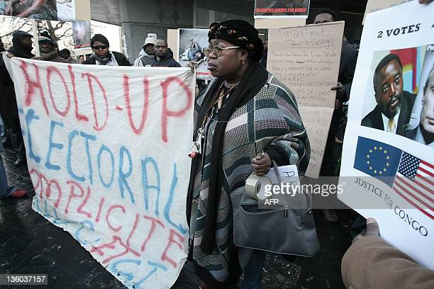 Congolese people hold banners and signs at the Matonge district in Brussels on December 17 2011 during a rally against the reelection of Joseph...