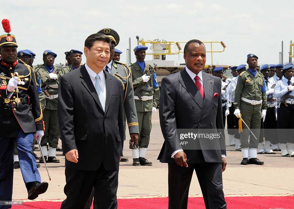 Congolese President Denis Sassou Nguesso (R) welcomes China's new President Xi Jinping (L) on March 29, 2013 upon his arrival at Brazzaville's Maya-Maya airport on the final leg of a three-nation Africa tour that has underscored Beijing's growing presence in the resource-rich continent. AFP PHOTO / Laudes Martial Mbon