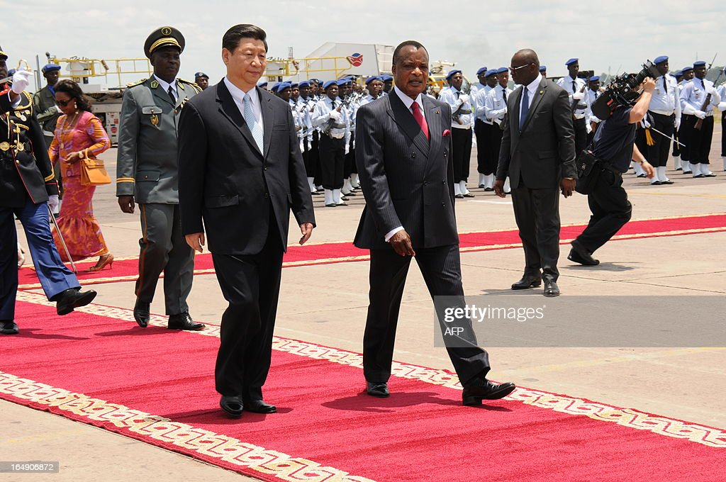 Congolese President Denis Sassou Nguesso (R) welcomes China's new President Xi Jinping on March 29, 2013 upon his arrival at Brazzaville's Maya-Maya airport on the final leg of a three-nation Africa tour that has underscored Beijing's growing presence in the resource-rich continent. AFP PHOTO / Laudes Martial Mbon
