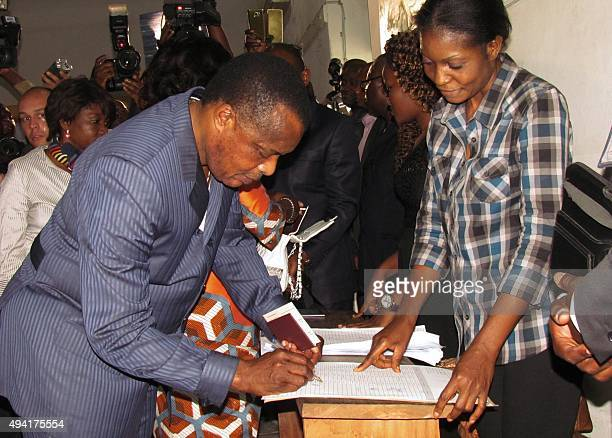Congolese President Denis Sassou Nguessou arrives to cast his ballot on October 25 2015 in Brazzaville People in the Republic of Congo began voting...