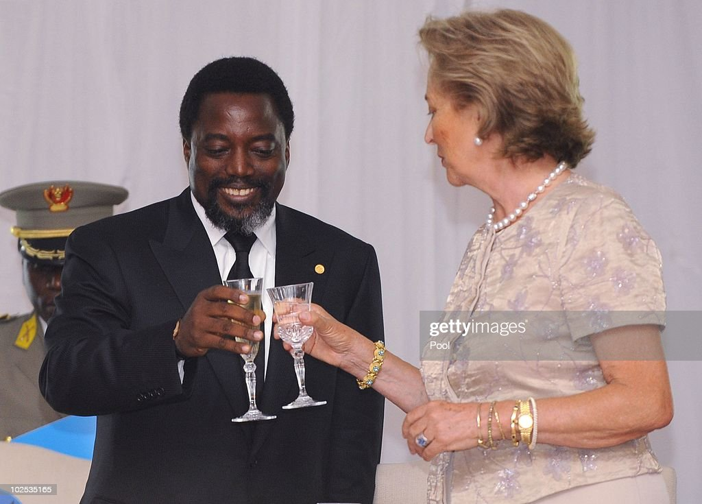 Congolese President Joseph Kabila (L) and Queen Paola of Belgium attend a gala dinner at Cite de l'Union Africaine on June 29, 2010 in Kinshasa, Democratic Republic of Congo. King Albert II of Belgium and Queen Paola of Belgium are in Congo for a 3-day State visit and to attend the 50th anniversary of the independence of the Democratic Republic of Congo.