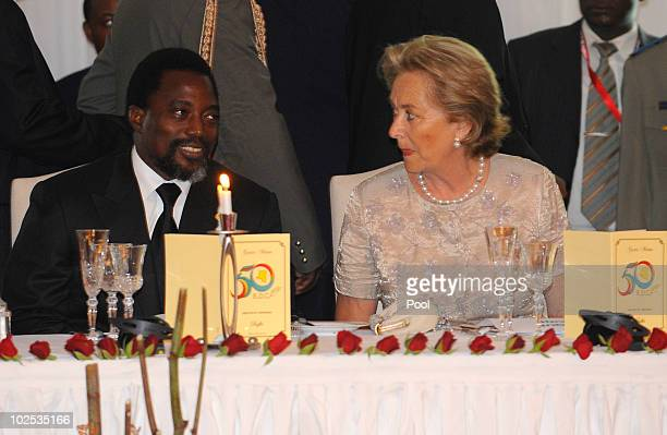 Congolese President Joseph Kabila and Queen Paola of Belgium attend a gala dinner at Cite de l'Union Africaine on June 29 2010 in Kinshasa Democratic...
