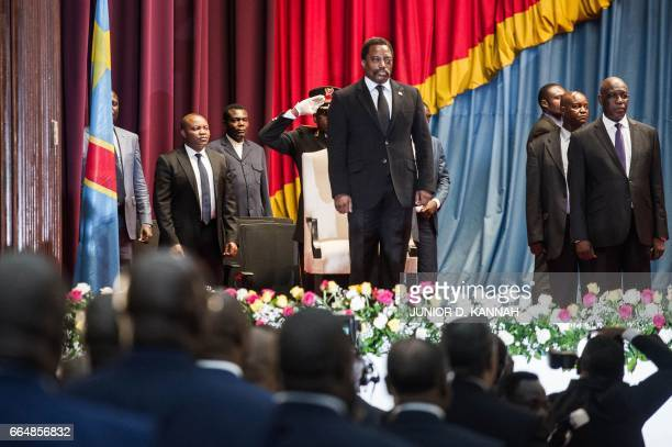 Congolese President Joseph Kabila arrives to deliver a speech to the nation in front of the upper and the lower chambers at the Palace of the People...