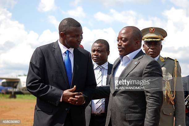 Congolese President Joseph Kabila is greeted by unidentified local officials on October 29 2014 as he arrives at the Mavivi airport in Beni some 12...