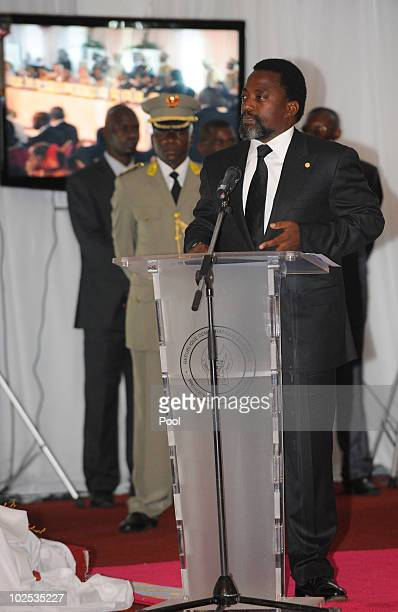 Congolese President Joseph Kabila speaks at a gala dinner at Cite de l'Union Africaine on June 29 2010 in Kinshasa Democratic Republic of Congo King...