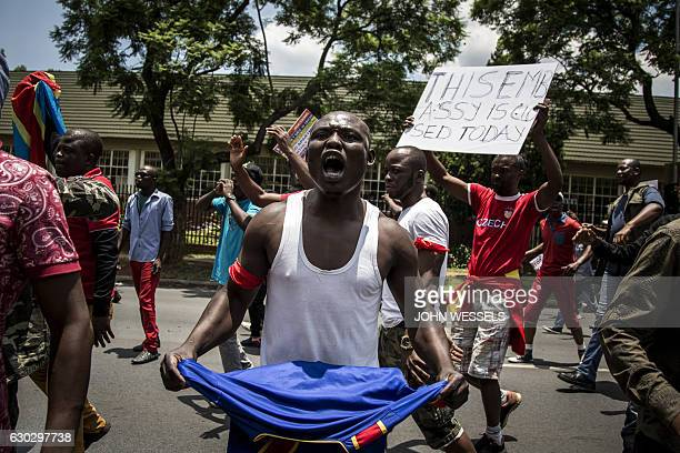 A Congolese protester holds a book of the DRC's constitution in defiance against the President of the Democratic Republic of the Congo Joseph Kabila...