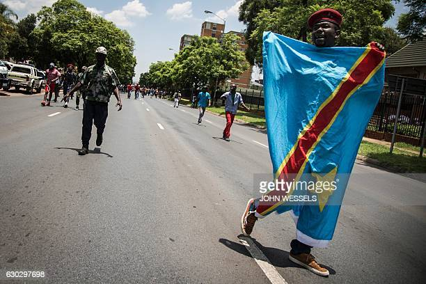 Congolese protesters arrive outside the embassy of the Democratic Republic of the Congo in defiance against the President of the Democratic Republic...