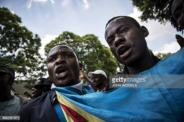 Congolese protesters shout as they arrive outside the embassy of the Democratic Republic of the Congo in defiance against the President of the...