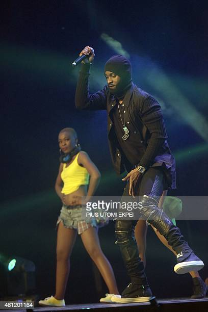 Congolese singersongwriter Fally Ipupa entertain guests during the CAF African Footballer of the Year Award in Lagos on January 8 2015 Manchester...