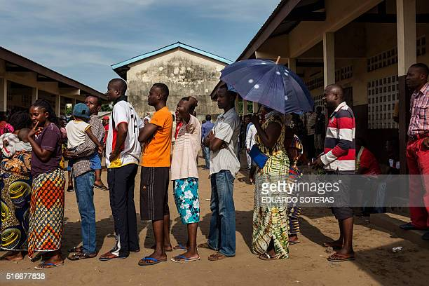 Congolese voters queue outside a polling station during presidential elections in Brazzaville on March 20 2016 Congo began voting on March 20 under a...