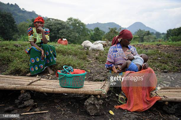 A Congolese woman breastfeeds her child in an empty market in the village of Rangira several kilometres from the town of Rutshuru in the Democratic...