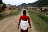 A Congolese woman walks on September 3 2010 down the main road in the village of Luvungi that was attacked on July 30 by Hutu rebels of the...