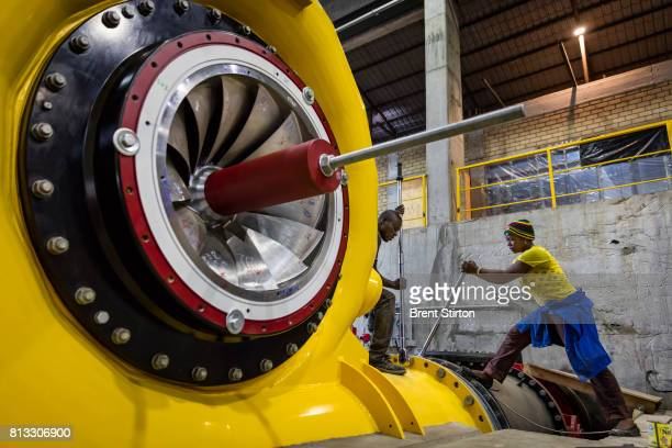 Congolese workers at work inside the turbine hall at Matebi Hydroelectric station The powerstation is an initiative of Virunga National Park and when...