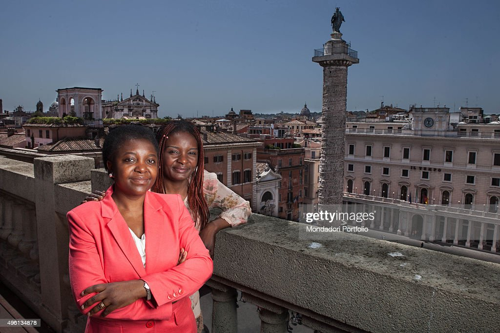 Congolese-born Italian politician and Minister of Integration <a gi-track='captionPersonalityLinkClicked' href=/galleries/search?phrase=C%C3%A9cile+Kyenge&family=editorial&specificpeople=10908084 ng-click='$event.stopPropagation()'>Cécile Kyenge</a> (Kashetu Kyenge) and her sister Dora Kyenge posing for a photo shooting on the terrace of the building of Ministry of Integration of the Italian Republic. Rome, Italy. June 2013