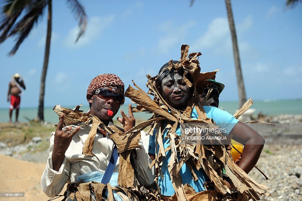 'Congos' dance during the so called 'Congos y Diablo', Congos and Devil, carnival ritual in Nombre de Dios 120 km north to Panama City on February 13, 2013 . The celebration dates to colonial times with devils representing the Spanish conquerors and the 'Congos' African slaves. AFP PHOTO/ Rodrigo ARANGUA