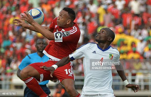 Congo's defender Boris Moubio Ngonga challenges Equatorial Guinea's midfielder Emilio Nsue during the 2015 African Cup of Nations group A football...