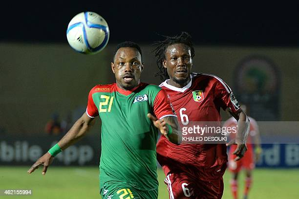 Congo's defender Dimitry Davy Magnokele Bissiki challenges Burkina Faso's midfielder Abdou Razack Traore during the 2015 African Cup of Nations group...